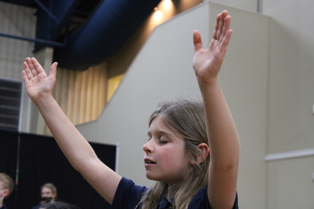 girl with arms in air